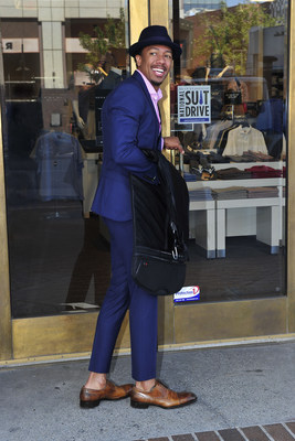 Nick Cannon makes a Suit Drive donation at his local Men's Wearhouse store