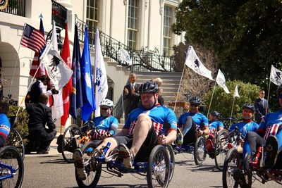 Wounded veterans are greeted by President Obama as they ride past the White House during the 2015 Wounded Warrior Project Soldier Ride event.