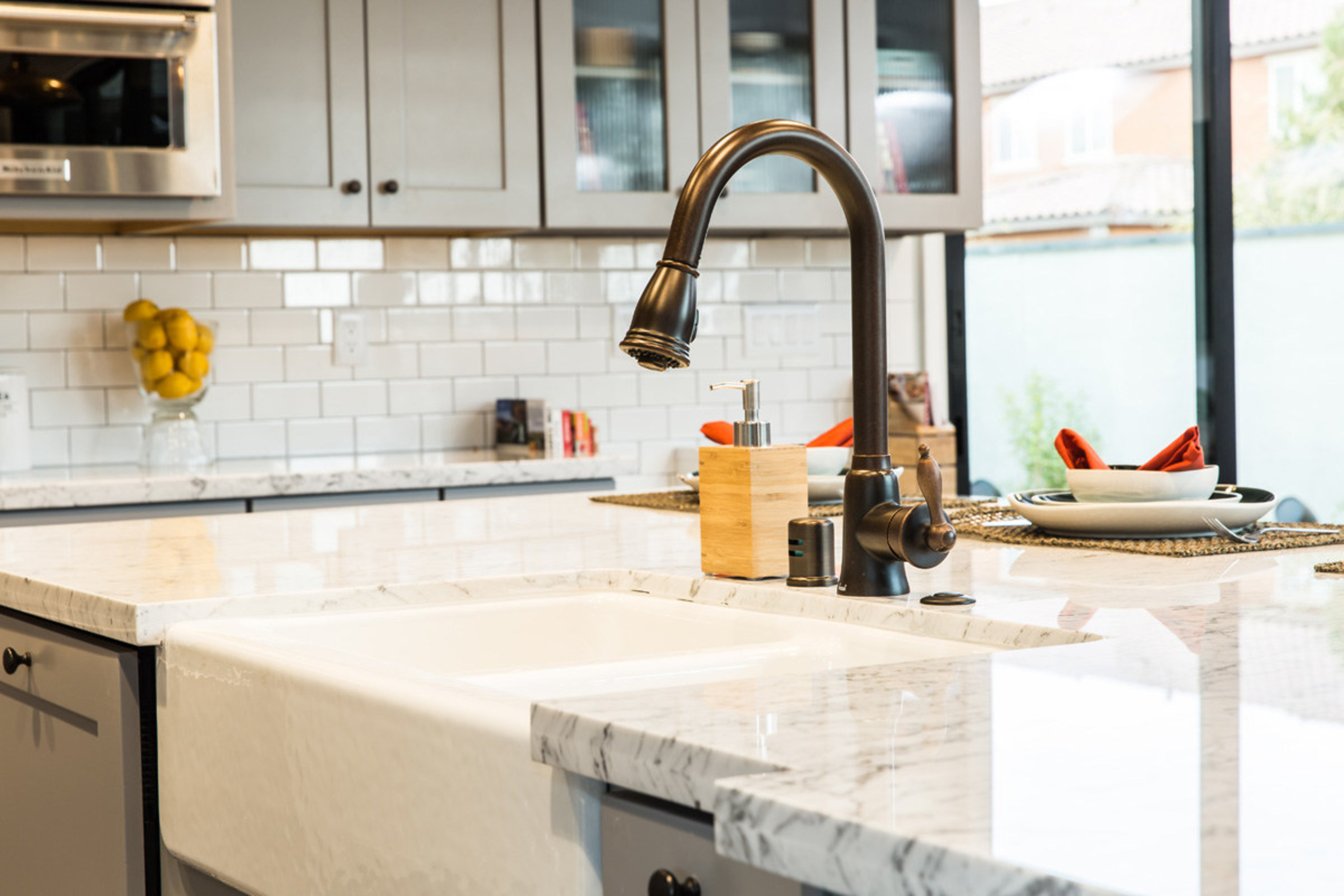 Responsive Home Creative Director Bobby Berk paired a white farmhouse sink with a Danze pull-down faucet in a tumbled bronze finish. The juxtaposition of mixing and matching elements such as these are at the heart of millennial style. (BPT)