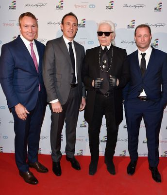 Karl Lagerfeld with Todd Cowan and Jordan Dermer, Managing Partners of CD Capital Developments and Peter Freed, President of Freed Developments, in Toronto Canada on April 1, 2015 (PRNewsFoto/Art Shoppe Lofts + Condos)