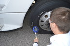 A Goodyear Tire & Rubber Company tire test engineer checks the pressure on a tire equipped with the company's Air Maintenance Technology.