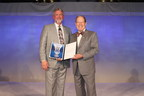 CAP President Gene N. Herbek, MD, FCAP, congratulates Stanley J. Robboy, MD, FCAP, who was named CAP Pathologist of the Year at the College of American Pathologists' annual meeting on Sept. 7, 2014. (PRNewsFoto/CAP)