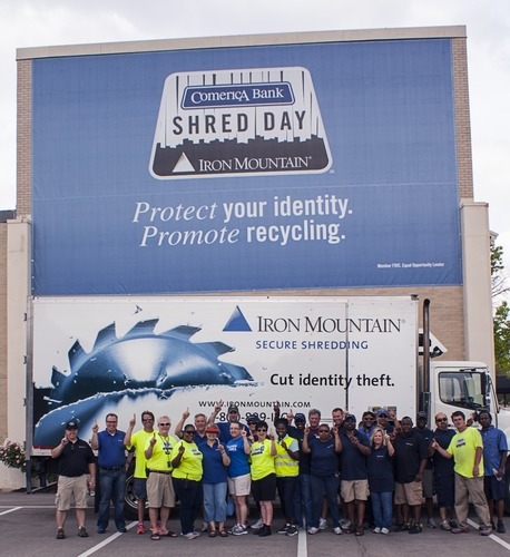 "Representatives from Comerica Bank and Iron Mountain pose for a group shot upon hearing news of earning a Guinness World Record(R) achievement for ""The Most Paper Collected in a 24-Hour Period"" at the fourth annual Shred Day DFW in Dallas, Texas on Saturday, April 26, 2014. A total of 401,925 pounds of paper was collected and recycled, which surpassed the previous world record by more than 63 tons.  (PRNewsFoto/Comerica Bank/Iron Mountain)"
