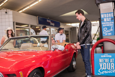 Jason Perls Miller, 28, of Culver City, CA with his 1970 Ford Mustang Convertible purchased gas for 35 cents a gallon during the Hagerty vintage gas station event celebrating National Collector Car Appreciation Day.