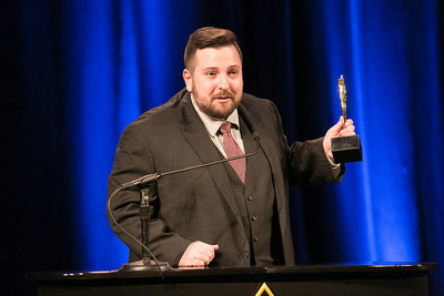 Ben Mascow accepts Gold Stevie Award on behalf of David Pate
