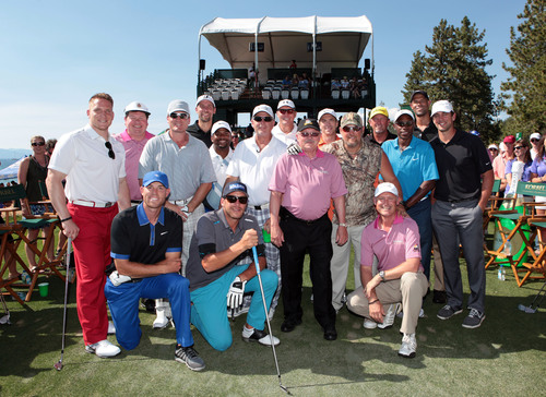 Sports and entertainment superstars pose with Korbel California Champagne owner and president Gary Heck during ...