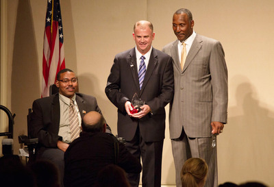 The Vehicle Production Group's CEO John Walsh joins the PVA's Craig Carpenter (l.) and ex-Chicago Bears linebacker Otis Wilson during the PVA's award gala on Oct. 1.  (PRNewsFoto/Vehicle Production Group)