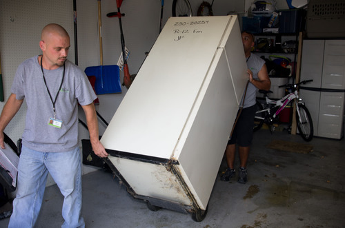 ARCA, Inc. collection crew removing NIPSCO's 5,000th unit.  (PRNewsFoto/Appliance Recycling Centers of America, Inc.)