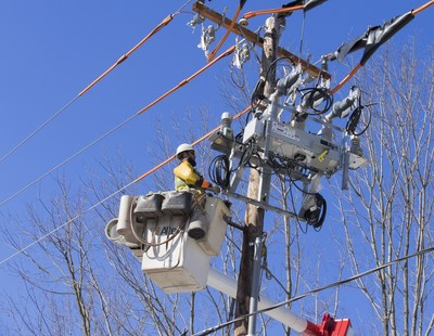 A PPL Electric Utilities line worker installs a smart grid switch in their Pennsylvania service territory. The company recently implemented the technology, which enables automated power restoration in minutes.