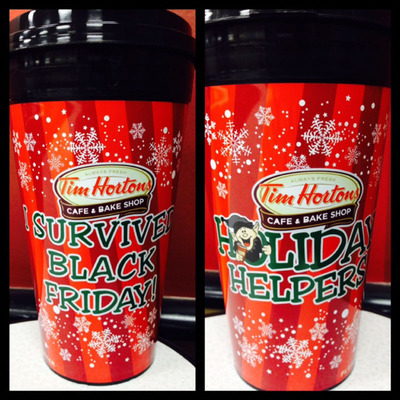 """Tim Hortons Cafe & Bake Shop treats Black Friday retail workers with special """"I Survived Black Friday"""" mug and free coffee all weekend long. (PRNewsFoto/Tim Hortons) (PRNewsFoto/TIM HORTONS)"""
