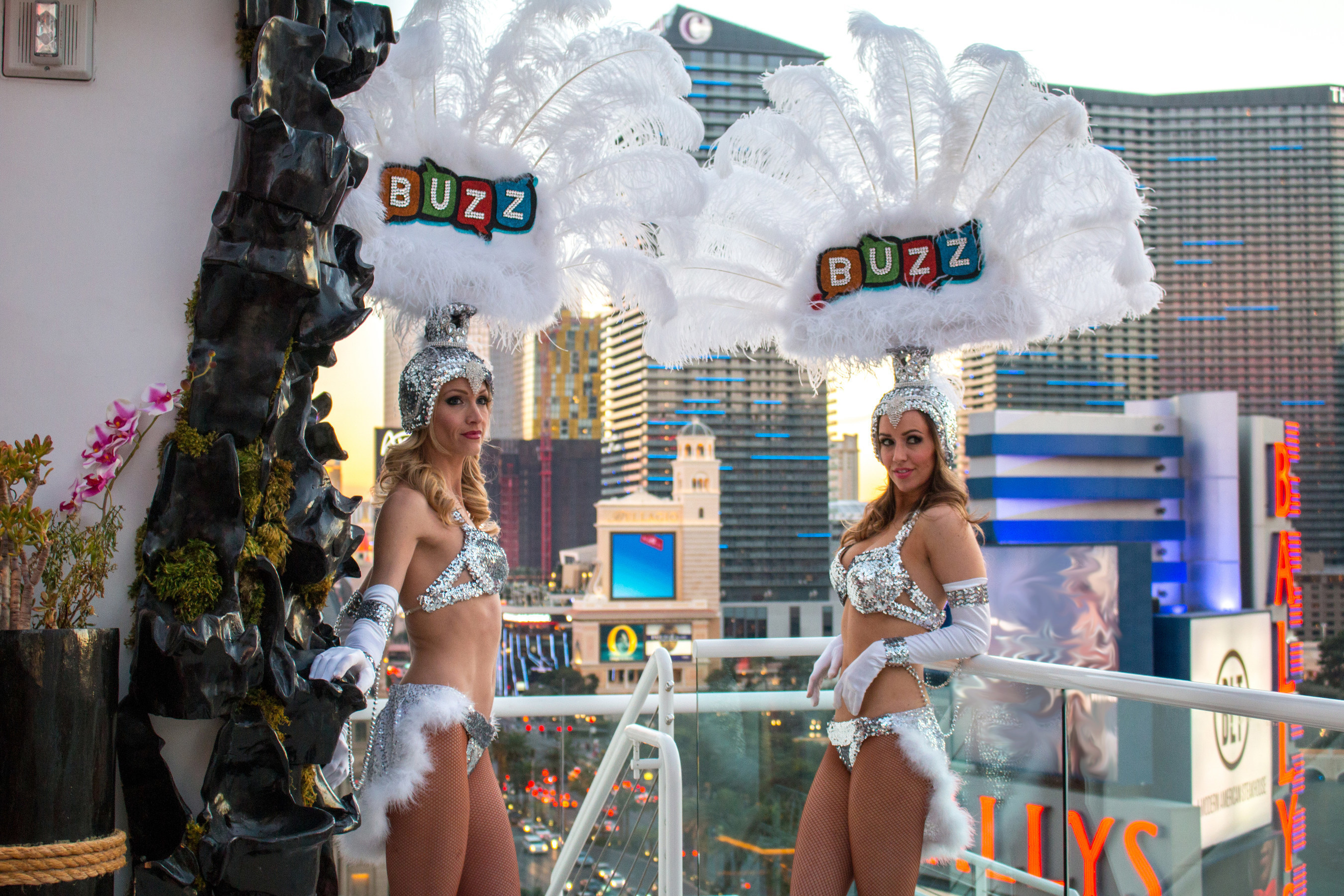 .BUZZ Showgirls, Smithy and Mariah, are among a legion of actual Vegas showgirls who will take their high-tech, GoPro(TM)-enabled showgirl costumes on a journey around the globe to review shows in the world's top travel destinations, including Vegas, New York, Paris and London.