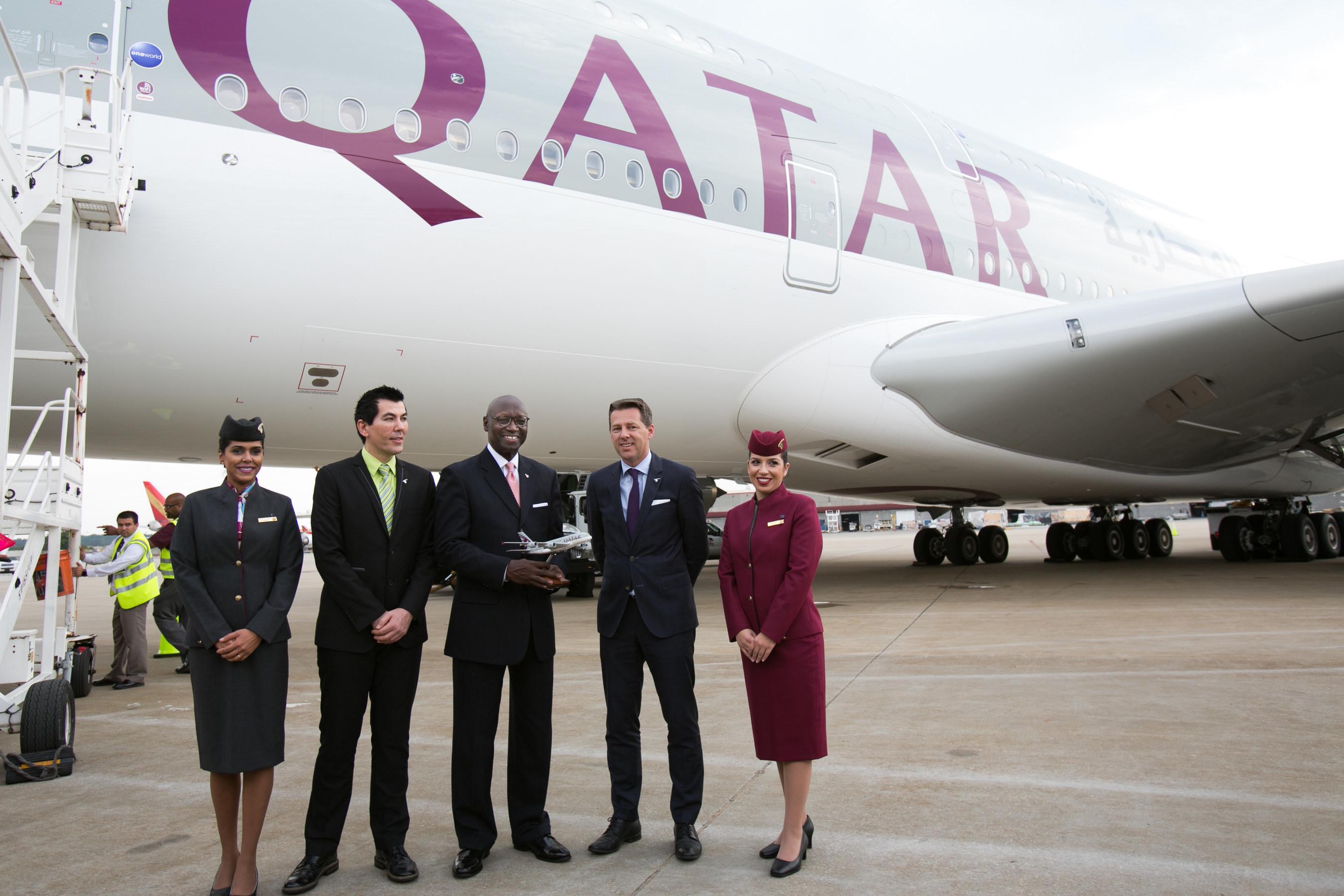 Qatar Airways Senior Vice President Customer Experience Rossen Dimitrov (left), Interim Airport Director Roosevelt Council Jr. (center) and Qatar Airways Vice President of Americas Gunter Saurwein exchange gifts before welcoming media aboard Qatar Airways' A380