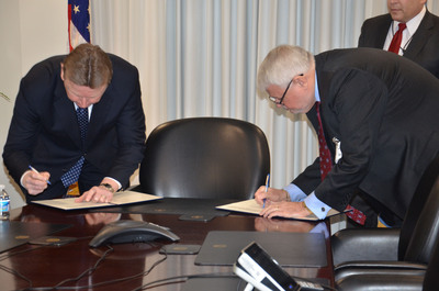 Defense Contract Audit Agency Director Patrick Fitzgerald (L) and American Federation of Government Employees National President J. David Cox Sr. sign a new contract for DCAA bargaining unit employees Feb. 6, 2014, at DCAA's headquarters in Ft. Belvoir, VA.  (PRNewsFoto/American Federation of Government Employees, Chelsea Bland, AFGE Communications)