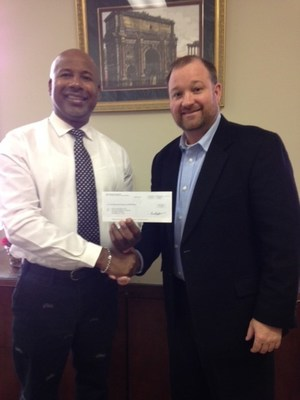 Liberty National Agency Owner Steve Harris (right) delivering his $2,500 donation to Boys and Girls Club of East Central Alabama Chief Professional Officer Johnny Byrd (left).