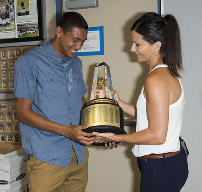 Michael Norman, left, of Vista Murrieta High School, is surprised with the 2014-15 Gatorade National Boys Track & Field Athlete of the Year trophy by Gatorade Marketing Manager Keri Lockett, Tuesday, June 30, 2015 in Murrieta, Calif. The award recognizes outstanding athletic excellence as well as high standards of academic achievement and exemplary character demonstrated on and off the field. Photo/Gatorade, Susan Goldman, handout.