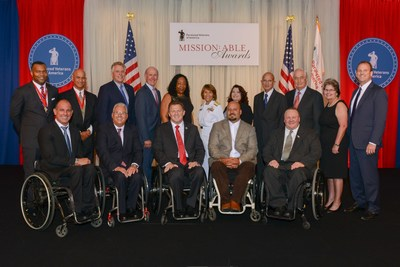 Honorees and Presenters pictured at Paralyzed Veterans of America's 2016 Mission: ABLE Awards, The Ritz Carlton, Washington, DC, September 21, 2016,Front row (L to R): Carlos Moleda, PVA member; Bob Molinatti, PVA member; Al Kovach, Jr., PVA National President; Jeff DeLeon, PVA member; Tom Wheaton, PVA National Treasurer; Back row (L to R): Horace Blackman, Sr. Vice President, Health, Leidos; Nadeem Butler, President and CEO, Technatomy Corporation; The Honorable Terry McAuliffe, Governor of Virginia; Steven C. Smith, President/CEO, K-VA-T Food Stores, Inc.; Thedra Adams, PAVE client; Vice Admiral Raquel C. Bono, MC, USN, Director, Defense Health Agency; Carol Hedley, Program Director, MSSA, Military Affairs, Microsoft; Major General Chris Cortez, USMC (Ret.). Vice President, Military Affairs, Microsoft; Roger Penske, Chairman, Penske Corporation; Kerry Reyna, PAVE client; Jonathan Scholl, President, Leidos Health and Engineering