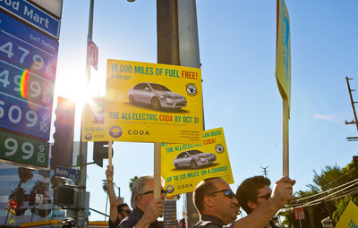 CODA Automotive Promotes its 10,000 miles in Free Fuel Offer in Front of a West Los Angeles Gas Station. Photo Credit - Eli Green, Bell & Ammo.  (PRNewsFoto/CODA Automotive)
