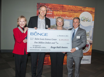 """Todd Bastean, CEO, Bunge North America and Geri Hayes, vice president, Human Resources, Bunge North America (center) present a check to Donna Wilkinson, Saint Louis Science Center Board of Commissioner, President, Board of Trustees (left) and Bert Vescolani, President and CEO, Saint Louis Science Center(right) to support the Science Center's recently announced permanent exhibit on agriculture, """"GROW."""""""