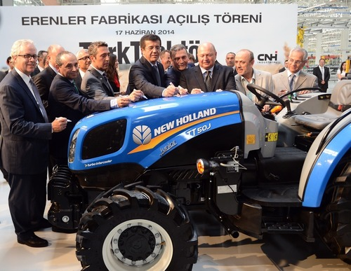 CNH Industrial CEO Richard Tobin (far left) and Chairman of the Board of Koc Holding, Mustafa V. Koc (third from right), sign a New Holland tractor that will be manufactured at the second CNH Industrial and Koc Holding  joint venture manufacturing plant in Turkey, inaugurated yesterday. (PRNewsFoto/CNH Industrial N.V.)