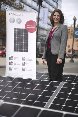 Senior Manager, Sustainability and CSR, Christine Ackerson with LG Solar's flagship LG NeON 2 panels at the Greenbuild International Conference & Expo on Thursday, Nov. 19, 2015 in Washington. LG, one of the Energy Star(R) Partner of the Year 2015, is also a sponsor of the Greenbuild International Conference & Expo. (Kevin Wolf/AP Images for LG Electronics)