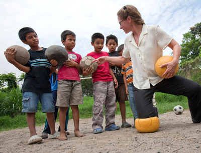One World Futbol Project Co-Founder Lisa Tarver demonstrates virtually indestructible footballs that will not deflate or puncture in Santa Gertrudis, El Salvador. Provided by Chevrolet in partnership with OWF, approximately 1.5 million footballs will be donated by Chevrolet to youth in war-stricken zones, refugee camps, disaster areas, and other disadvantaged communities around the word. The automaker's pledge will be fulfilled through a global network of organizations dedicated to helping empower the next generation of footballers. Its support is part of a companywide global football initiative that includes sponsorship of Barclays Premier League giant, Manchester United team (Chevrolet News Photo).  (PRNewsFoto/General Motors)
