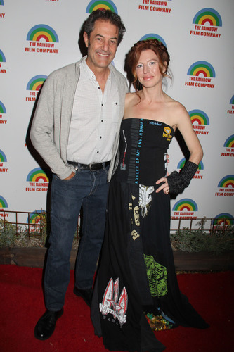 Actress Tanna Frederick and Pro Surfer Shaun Tomson at the 2013 Project Save Our Surf Holiday Celebration and Fundraiser. (PRNewsFoto/Project Save Our Surf) (PRNewsFoto/PROJECT SAVE OUR SURF)