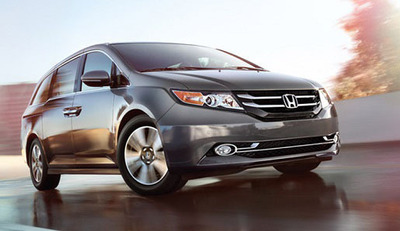 The 2014 Honda Odyssey has improved fuel-economy over previous versions thanks to the addition of a six-speed automatic transmission. Some trims features an on-board vacuum cleaner to help owners keep ahead of potential messes.  (PRNewsFoto/Howdy Honda)