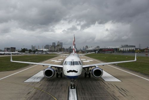 In the shadows of Canary Wharf, at London City Airport a British Airways aircraft is adorned with its own Movember moustache. (PRNewsFoto/London City Airport)