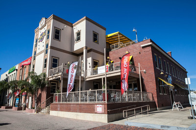 "Fuddruckers(R) is bringing the ""World's Greatest Hamburgers(R)"" back to Galveston, Texas just in time for the Gulf Coast island's annual Mardi Gras festivities in February.  The iconic, San Antonio-born fast casual brand has just opened its newest location in one of the company's oldest sites: the 1912 Armour & Co. building at 101 23rd (Tremont) Street.  (PRNewsFoto/Luby's Fuddruckers)"
