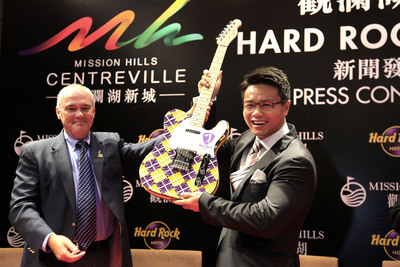 Hamish Dodds, president and CEO of Hard Rock International, and Dr. Ken Chu, chairman of Mission Hills Group, celebrate the announcement of Hard Rock Hotels Shenzhen and Haikou at a press conference on Sept. 10, 2012 in Shenzhen, China.  (PRNewsFoto/Hard Rock International)