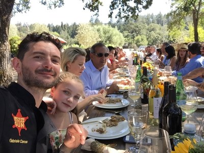 Gabriele Corcos of Cooking Channel's Extra Virgin enjoys Madrigal Family Winery Sauvignon Blanc with owner Chris Madrigal at Madrigal Family Winery in Calistoga