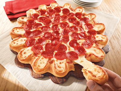 IT'S HERE! PIZZA HUT(R) LAUNCHES CRAZY CHEESY CRUST PIZZA.  (PRNewsFoto/Pizza Hut)