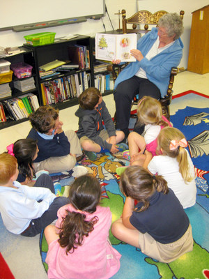 Dominican Sister of Peace reads to children at Saint Gregory Elementary School in Kentucky.