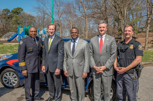 Georgia Power donated an all-electric Nissan Leaf to the Atlanta Police Foundation on March 20 to assist the Atlanta Police Department in providing public safety to the Atlanta BeltLine and surrounding communities. The donation occurred at Washington Park in southwest Atlanta. Pictured (left-right): Atlanta Police Chief George N. Turner; Georgia Power President & CEO Paul Bowers; Atlanta Mayor Kasim Reed; Police Foundation President & CEO Dave Wilkinson; and Atlanta Police Lt. Jeff Baxter.  (PRNewsFoto/Georgia Power)