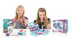 Girls using the Pom Pom Wow Decoration Station to adorn personal items with pom-pom flourishes (Stick. Pull. Wow! process).