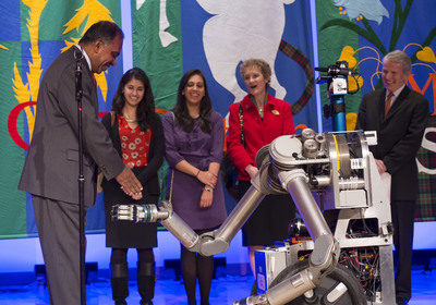 Welcome to Carnegie Mellon University: CMU robot HERB greets President-Elect Dr. Subra Suresh during a reception to welcome him to the university's Pittsburgh campus as his daughters, Meera and Nina, wife, Mary, and CMU Board of Trustees Chairman Ray Lane watch. On Feb. 5, the university named Suresh as its ninth president, effective July 1. He is succeeding CMU President Jared L. Cohon, who is stepping down after 16 years. Director of the National Science Foundation, Suresh previously served as dean of the School of Engineering at the Massachusetts Institute of Technology. Photo courtesy of Carnegie Mellon University.  (PRNewsFoto/Carnegie Mellon University)