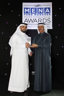 (From right to left)His Excellency Sultan Bin Saeed Al Mansoori, UAE's Minister of Economy, presents Ahmed Bin Sualyem, Executive Chairman, DMCC, with the award for 'Outstanding Contribution to Islamic Finance' at the MENA Fund Manager Performance ceremony and gala dinner (PRNewsFoto/DMCC)