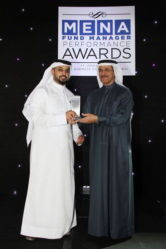 (From right to left)His Excellency Sultan Bin Saeed Al Mansoori, UAE's Minister of Economy, presents Ahmed ...