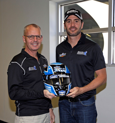 Jimmie Johnson, along with Mike Wells, president and CEO of Wells Enterprises, maker of Blue Bunny Ice Cream announced the launch of the 2014 edition of the Blue Bunny Helmet of Hope campaign.