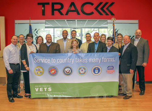 Union Pacific employees and military veterans present a $150,000 donation to Wounded Warrior Project (WWP) representatives at WWP's San Antonio TRACK facility, Monday, April 21, 2014. (PRNewsFoto/Union Pacific)