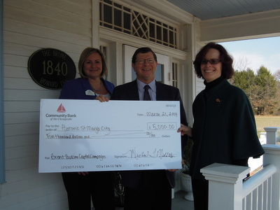 From left to right: Community Bank representatives Sandy Galan, Branch Market Manager, St. Mary's County and Michael Middleton, Chief Executive Officer, present donation check to Regina M. Faden, Executive Director of Historic St. Mary's City.