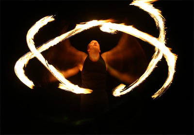 Juggling Inferno Fire Performers - Under New Management.  (PRNewsFoto/Juggling Inferno Fire Performers)