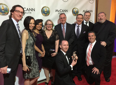 Executives at AbelsonTaylor and guests pose with their Heart Award
