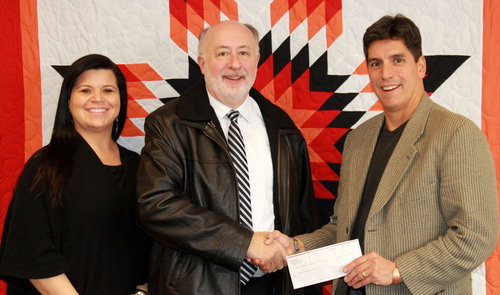 L to R: Sarah Echohawk, executive vice president of First Nations; Bill Black, vice president and executive director of the Comcast Foundation; and Michael Roberts, president of First Nations.  (PRNewsFoto/First Nations Development Institute)