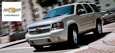 The 2014 versions of the Chevy Tahoe and Chevy Volt represent each end of the vehicle spectrum for Chevy. Both vehicles bring something to the table to attract customers. (PRNewsFoto/Chevrolet of Naperville) (PRNewsFoto/CHEVROLET OF NAPERVILLE)