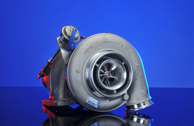 BorgWarner's latest B-series turbocharger with asymmetric twin scroll turbine housing helps new Mercedes-Benz 12.8-Liter Blue Efficiency Power Engine Achieve Exceptional Fuel Economy, Improved Performance and Low Emissions.  (PRNewsFoto/BorgWarner Inc.)