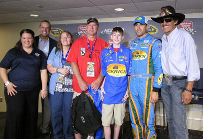 "L to R: Sarah Davis, Operation Homefront; Kyle Petty, co-founder Victory Junction; Cydney Mowery, mother of Jarrett Correll; Joel Correll, Jarrett's father and veteran Marine; Jarrett Correll, Victory Junction camper; Aric Almirola, driver of the No.43 Eckrich Ford; and ""The King"" Richard Petty, NASCAR Hall of Famer and co-owner, Richard Petty Motorsports.  (PRNewsFoto/Eckrich)"