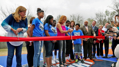 Gwyneth Lloyd, Executive Director, WorldVentures Foundation (left) and WNBA Star Nancy Lieberman (center), with representatives from NCAA, City of Arlington and Boys & Girls Clubs of Arlington - East Branch, cut the ribbon for Arlington's first DreamCourt on April 1.  (PRNewsFoto/WorldVentures Foundation)