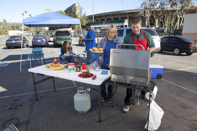 Plenty of table space and seating is a must at tailgating parties. Maximize your space with compact folding tables like this Lifetime Tailgate Table - an all-in-one table that features a large tabletop and an attached heavy-duty metal grill rack that conveniently folds inside the table for easy transportation and storage.  (PRNewsFoto/Lifetime Products)