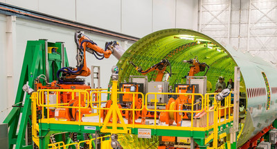 The Fuselage Automated Upright Build (FAUB) is a robotic manufacturing system being developed by KUKA Systems Aerospace Group for The Boeing Co. FAUB will automate most riveting on future Boeing 777s, including the new 777X. The robots will install up to 60,000 fasteners per fuselage, quickly and with great precision. (PRNewsFoto/KUKA Systems Corporation Nort...)